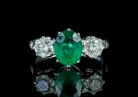 PLATINUM DIAMOND EMERALD TRILOGY RING 1.80CT EMERALD 1.20CT DIAMOND front